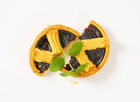 halved plum jam tart on white background Reklamní fotografie