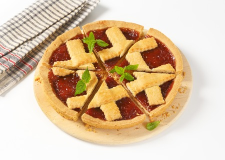 sliced strawberry jam tart with lattice on top