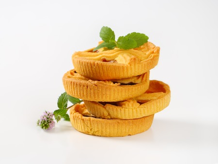 stack of apricot and plum jam tarts