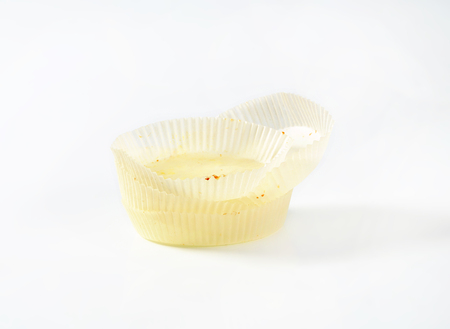 empty paper cupcake cases on white background