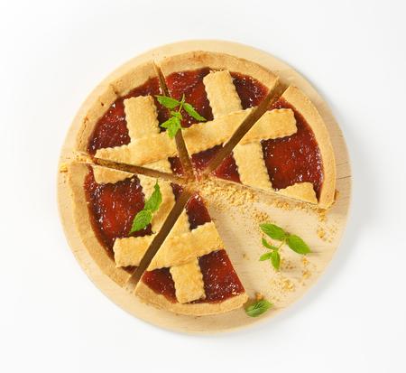 sliced strawberry jam tart with lattice on top