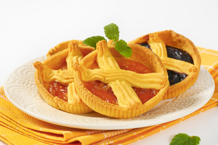 apricot and plum jam tarts on white plate Reklamní fotografie