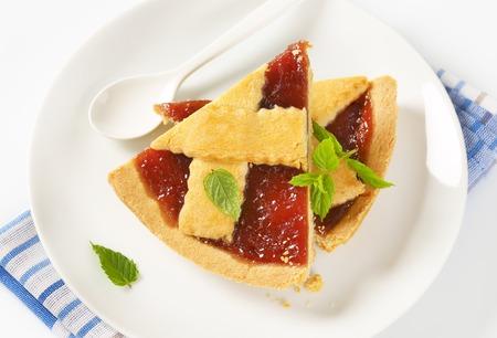 slices of strawberry jam tart  on white plate