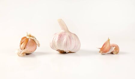 bulb and cloves of fresh garlic on white background Reklamní fotografie
