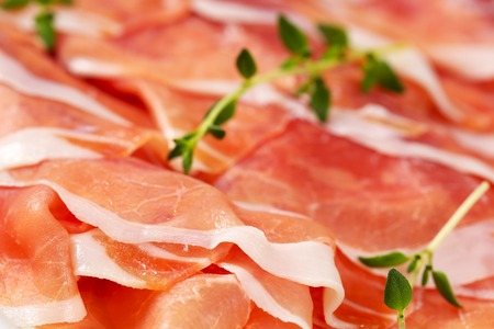detail of air dried ham slices with thyme - full frame Reklamní fotografie