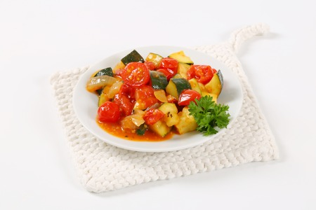 plate of grilled vegetables on white table mat