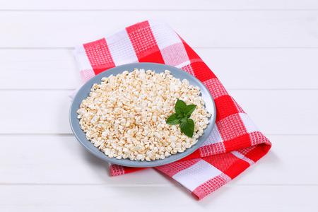 plate of puffed buckwheat on checkered place mat Stock Photo