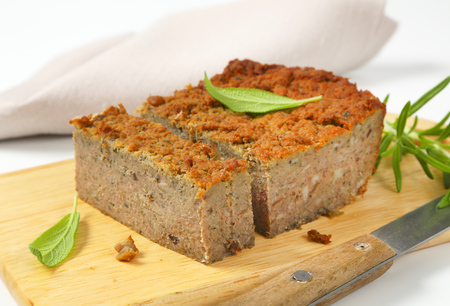 oven-baked pork and liver meatloaf on cutting board Stock Photo