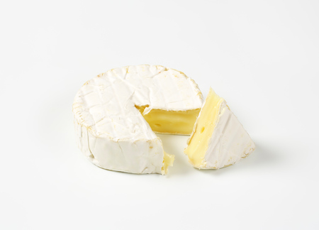 wheel of soft-ripened cheese with white rind