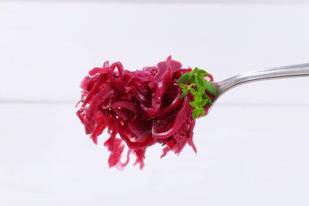 pickled red cabbage on fork