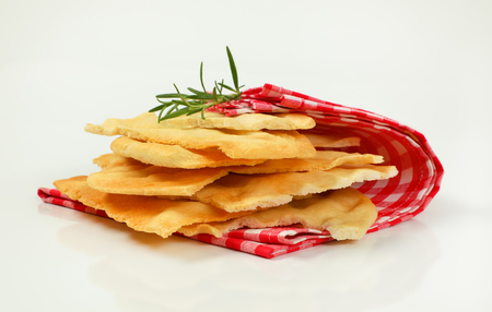 pieces of traditional Tuscan flatbread (Ghiottina Toscana) on checkered place mat