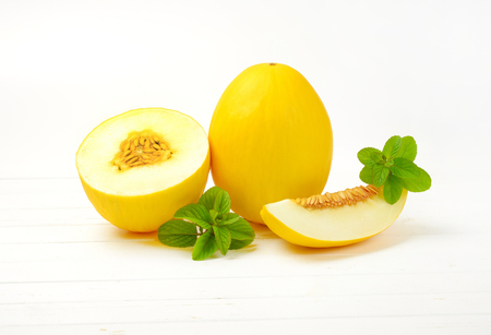 fresh yellow melons - whole, half and slice