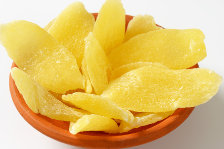 Dried pineapple slices in bowl