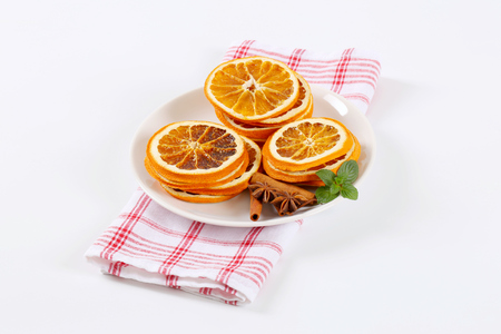 plate of dried orange slices with cinnamon and anise