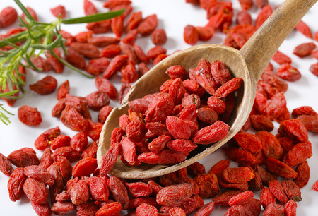 spoon of healthy goji berries - close up Stock Photo - 101584491