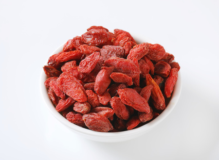 bowl of healthy goji berries on white background