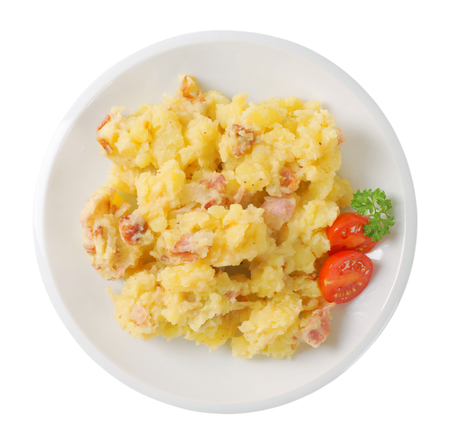 plate of mashed potatoes with bacon on white background 写真素材