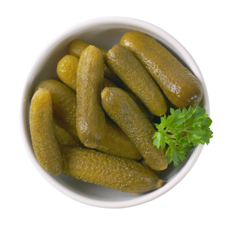 bowl of pickled cucumbers on white background Stockfoto