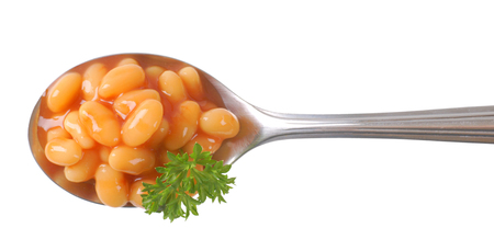 spoon of baked beans in tomato sauce