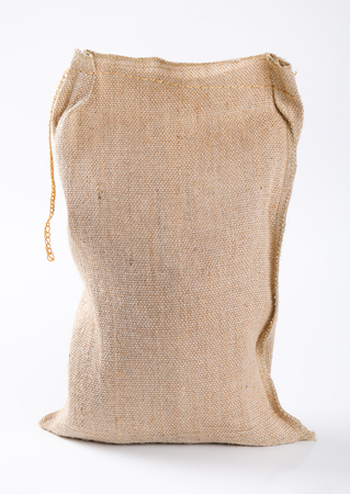 closed burlap sack on white background