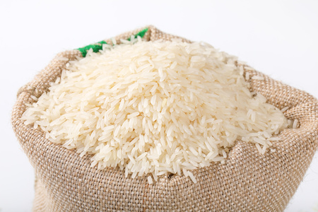 bag full of white long grained rice - close up Stock Photo