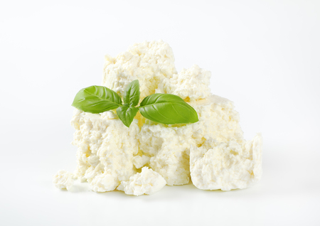 pile of crumbly white cheese on white background Reklamní fotografie - 106000205