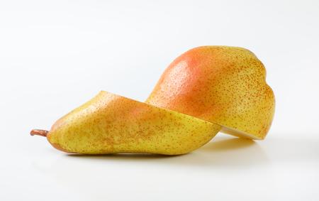 halved yellow pear on white background Reklamní fotografie