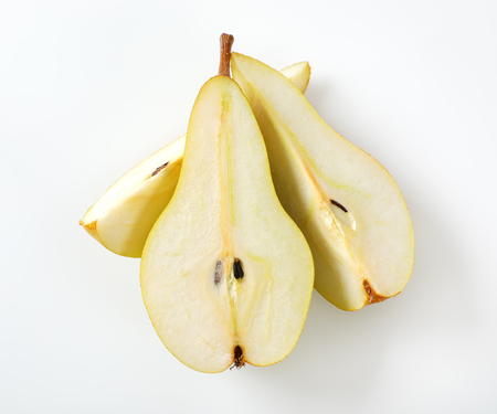 sliced yellow pear on white background