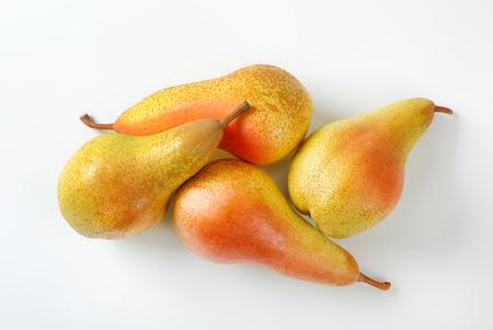 four ripe pears on white background Reklamní fotografie - 106000232