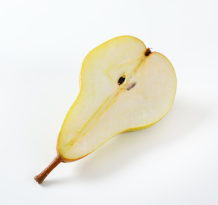half a yellow pear on white background Reklamní fotografie - 106000053