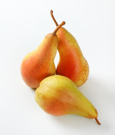 three ripe pears on white background Reklamní fotografie