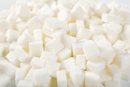 pile of white sugar cubes - close up