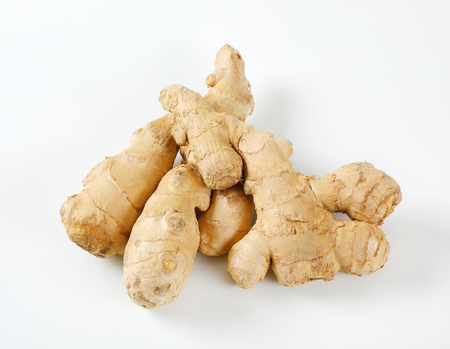 fresh ginger roots on white background