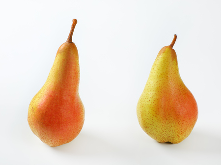 two ripe pears on white background