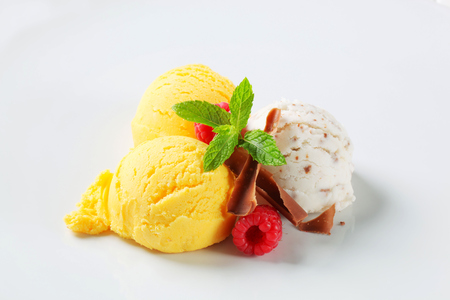 Scoops of ice cream with chocolate curls and fruit