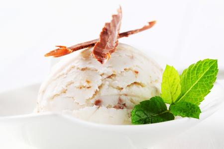Scoop of stracciatella ice cream topped with chocolate shavings Reklamní fotografie