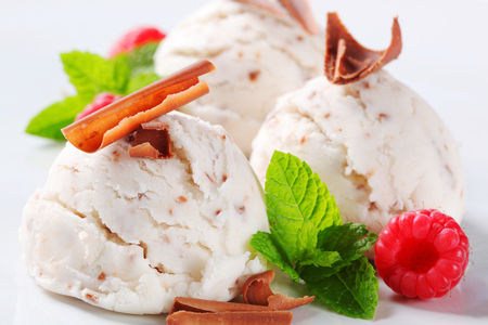 Scoops of stracciatella ice cream topped with chocolate shavings