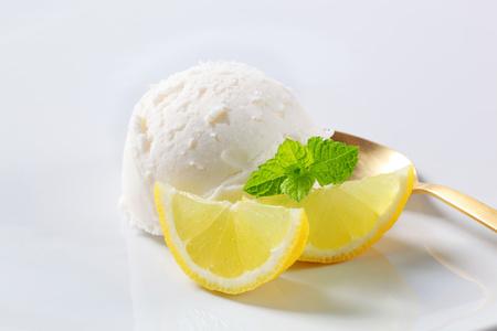 Scoop of white ice cream and slices of lemon