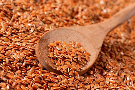Flaxseeds (also called linseeds) Reklamní fotografie - 111872050