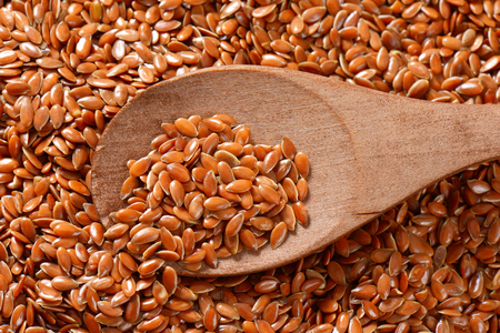 Flaxseeds (also called linseeds) Reklamní fotografie - 111872060