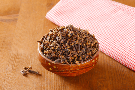 Dried cloves in a bowl