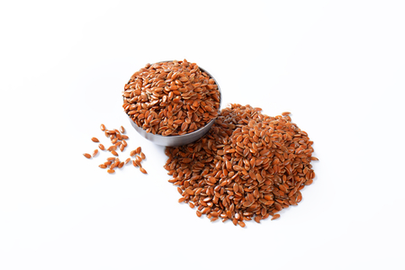 Flaxseeds (also called linseeds) Reklamní fotografie - 111871931