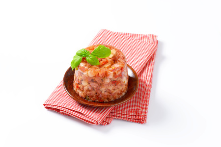 Pork meat with fresh chili pepper in aspic
