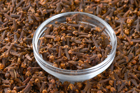 Dried cloves in a glass bowl