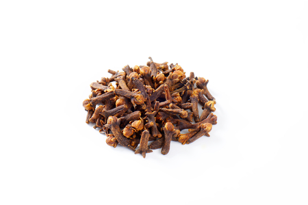 Heap of dried cloves on white background