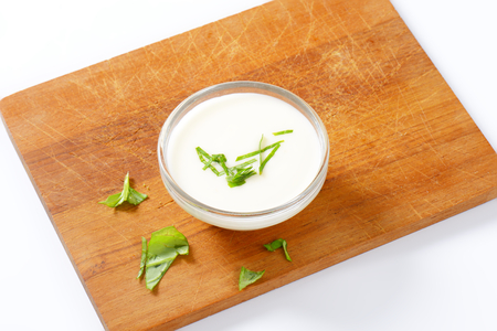 Bowl of creamy salad dressing with onion flavor