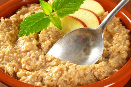 Bowl of white oats porridge