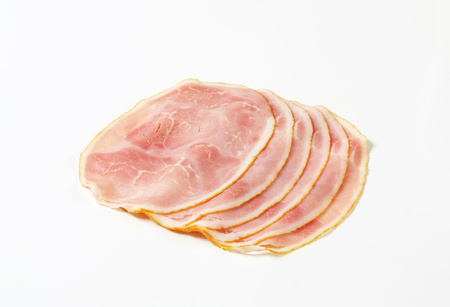 Thin slices of cooked ham on white background Reklamní fotografie - 115159753