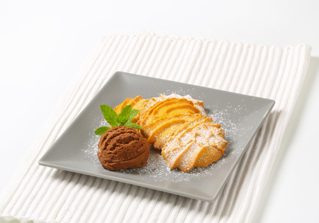 Spritz butter cookies and scoop of chocolate ice cream