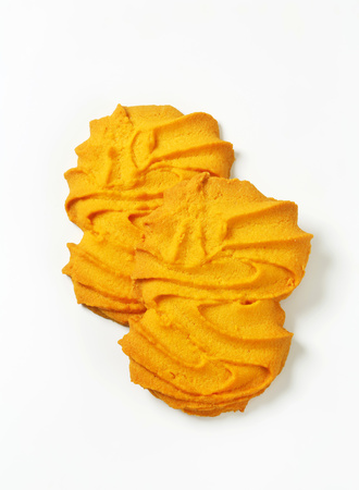 Vanilla Spritz cookies on white background